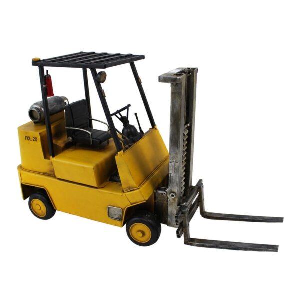 Chariot élévateur en métal jaune