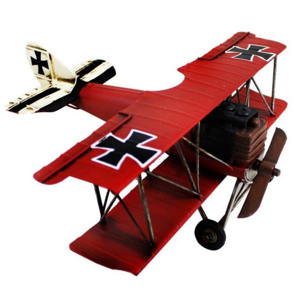 Avion biplan en métal rouge antique